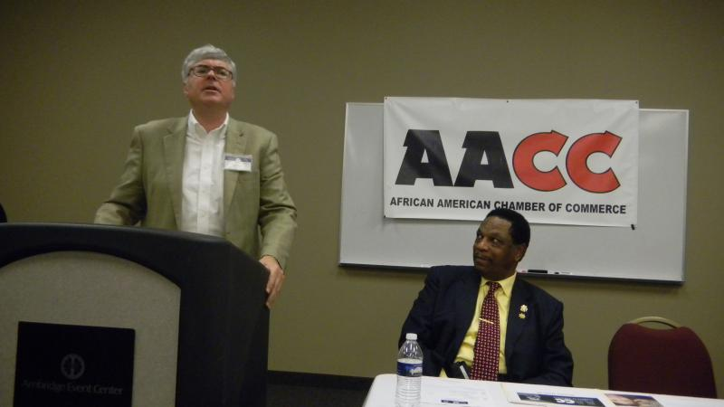African American Chamber of Commerce President Roy Jay watches as Republican Attorney General nominee James Buchal speaks.