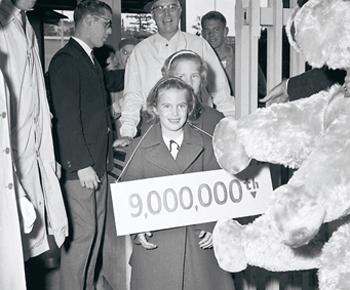 Six-year-old Paula Jones was the 9-millionth visitor to the Seattle World's Fair. She was given free admission to all of the rides, as long as she wore this sign around her neck.