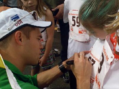 Nick Symmonds signs autographs during the Springfield 800.