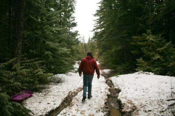 Shaun Patrick Winkler walks along an access road to his compound near Dufort road in Priest River, Idaho.