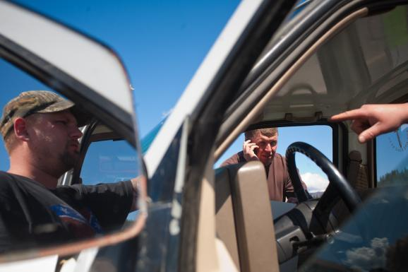 Shaun Patrick Winkler talks on the phone when Mark Eliseuson's truck breaks down in Old Town, Idaho while they campaign for sheriff.