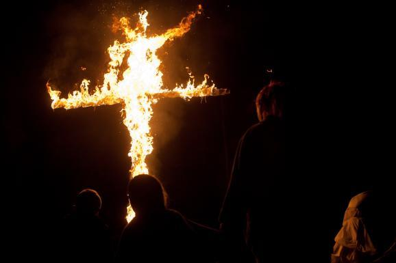 Shaun Patrick Winkler gives a speech about his Christian Identity beliefs during a cross burning ceremony on his compound outside of Priest River, Idaho.