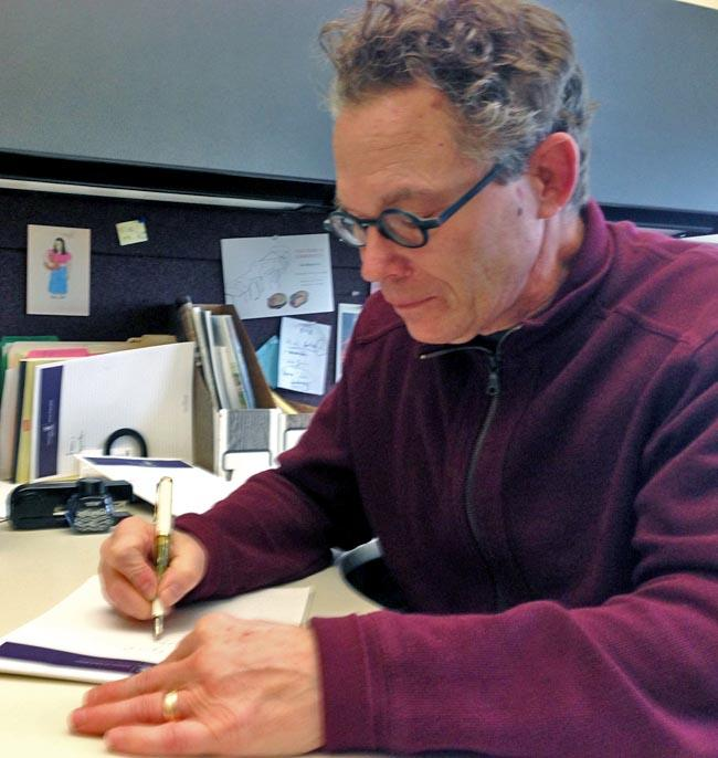 Rich Christen at the University of Portland has studied the history of teaching cursive handwriting. He keeps a fountain pen at his desk.