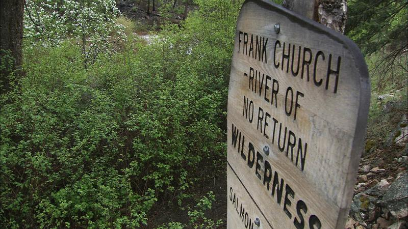 A sign marks the trail where hikers cross into the Frank Church Wilderness.