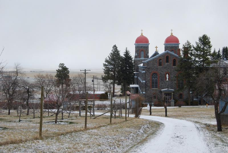 A view of St. Gertrude's Monastery from the trail that leads up through the seven stations of the cross, artistic depictions of the crucifixion of Christ. The trail also leads to a quiet grotto for mediation and the monastery cemetery. The fenced in orcha