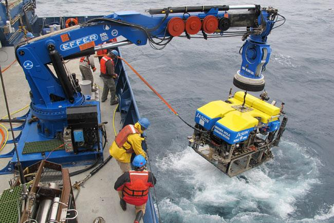 "Crew members of the R/V Atlantis recover the submersible ""Jason,"" after it connected a chain to an undersea seismometer off the coast of Oregon."