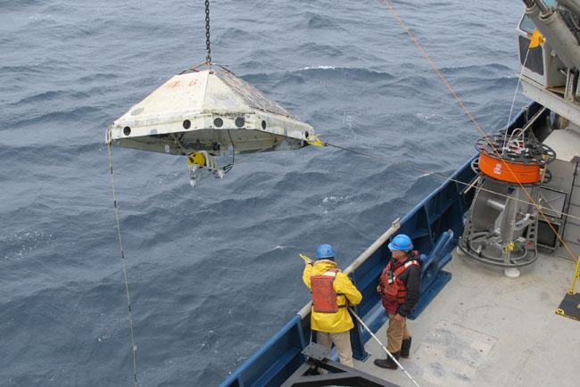 Researchers retrieve an ocean-bottom seismometer off the coast of Oregon on Wednesday.