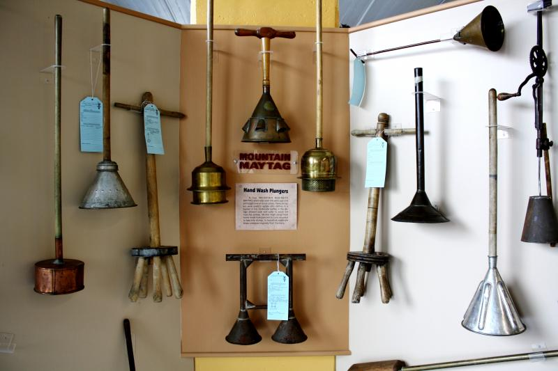 A display of antique plungers used for washing clothes at the Museum of Clean.