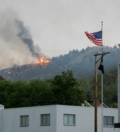 Wednesday a fire threatened homes and businesses in the town of John Day, Ore.