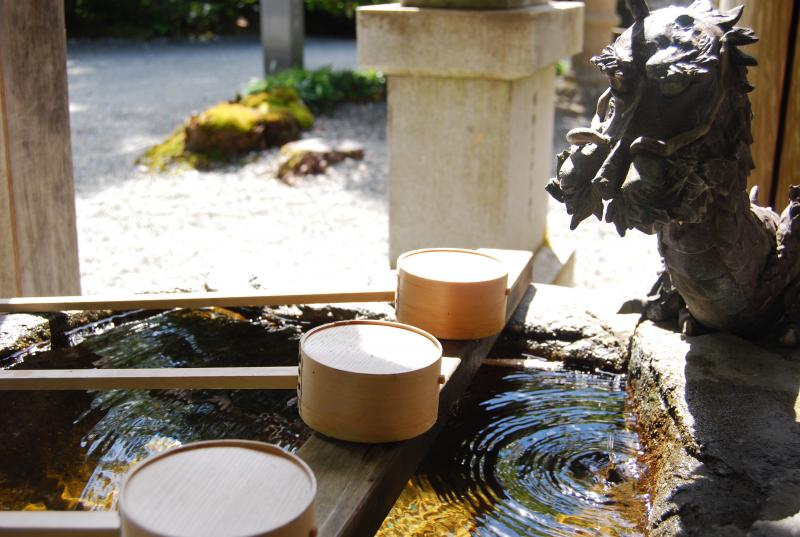 A fountain where visitors wash their hands and face before entering the shrine. There are picture directions above the fountain for new visitors on how to cleanse themselves.