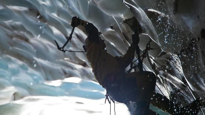 Eddy Cartaya ice climbing. During their week on the glacier, the team surveys the caves and searches for new passages.