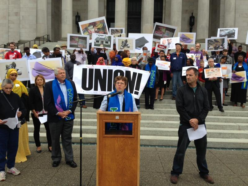 Prior to a Washington Supreme Court hearing, Sea-Tac Airport workers and others rally at a union-organized event in favor of the city of SeaTac's $15 an hour minimum wage law