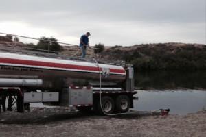 A semi releases Puget Sound steelhead into Rock Lake.