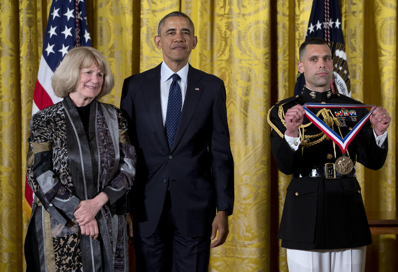 President Barack Obama stands with Mary-Claire King as she receives the National Medal of Science