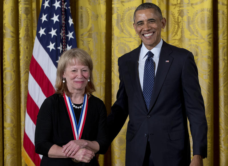 President Barack Obama stands with Dr. Geraldine Richmond as she receives the National Medal of Science