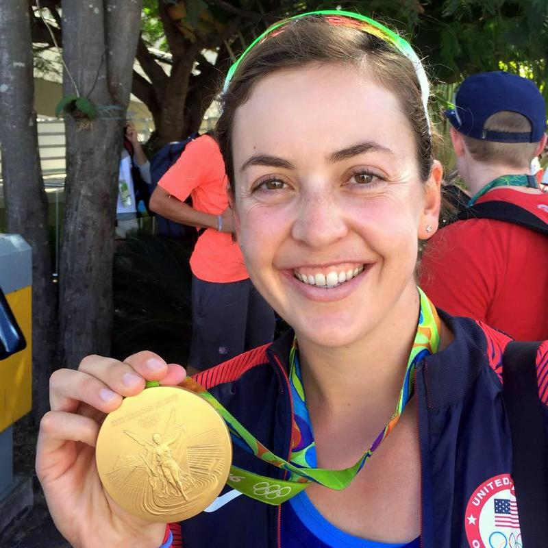 Former University of Washington rower Kerry Simmonds shows her Olympic gold medal, earned with the U.S. women's eight.