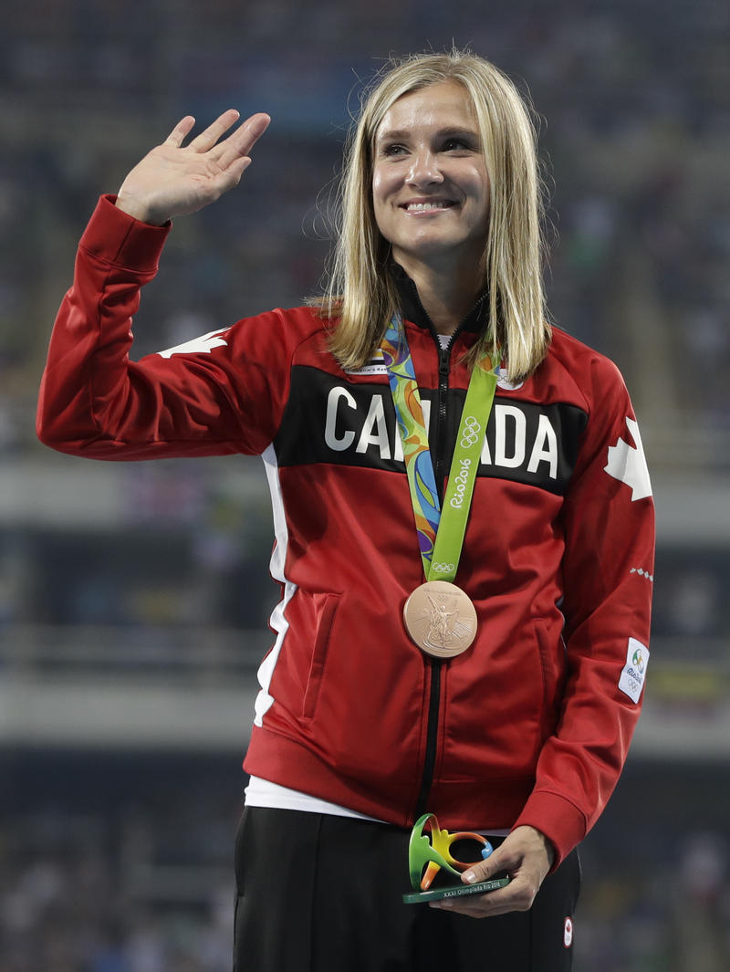 Heptathlon bronze medalist Canada's Brianne Theisen-Eaton wave from the podium during the athletics competitions of the 2016 Summer Olympics at the Olympic stadium in Rio de Janeiro, Brazil, Sunday, Aug. 14, 2016