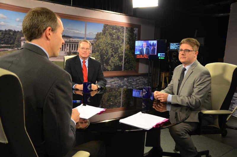 """Paul Guppy of the Washington Policy Center, left, and Peter McCollum of Integrity Washington speak with host Austin Jenkins on the set of TVW's """"Inside Olympia"""" program about Initiative 1464 which would create a publicly-financed option for campaigns."""