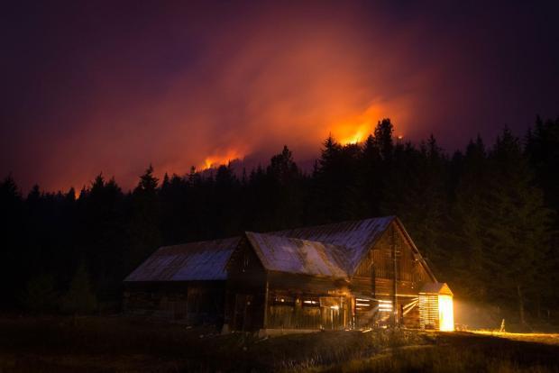 The Buck Creek/Saul Fire burning near a powerhouse.