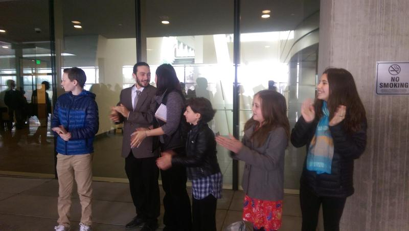 5 of the 21 youth plaintiffs applaud their attorneys after pre-trial conference at Eugene Federal Courthouse