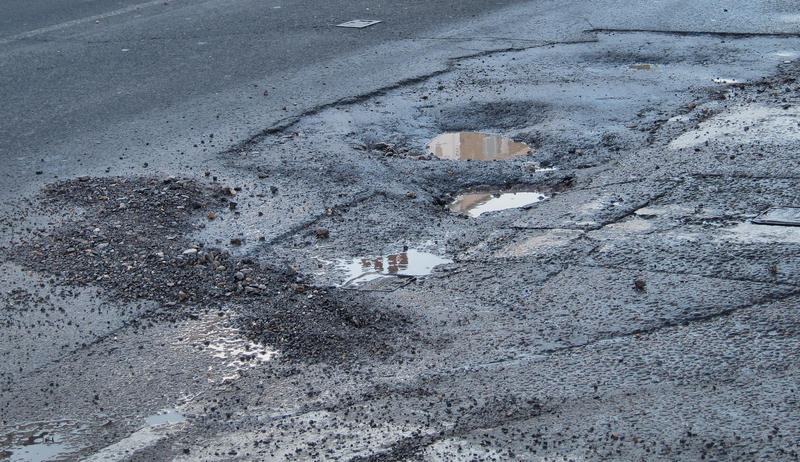 A familiar annoyance on the road this winter. The cycle of freeze and thaw in cracks create potholes.