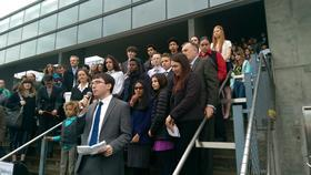 Young people suing the government in front of the Federal Courthouse in Eugene.