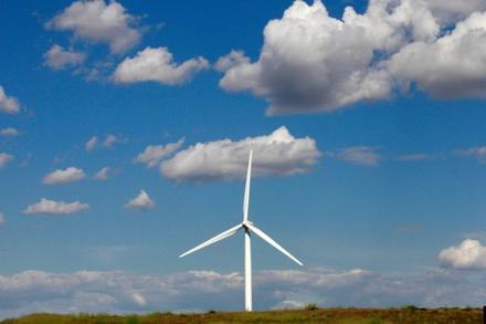 A wind turbine stands near Arlington, Oregon. A new study shows the Northwest economy might actually benefit from climate change.