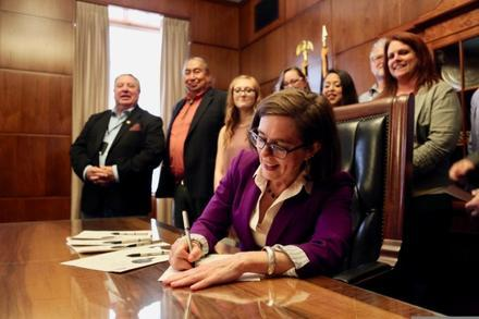 Oregon Gov. Kate Brown signs a bill in this June 27, 2017, file photo.