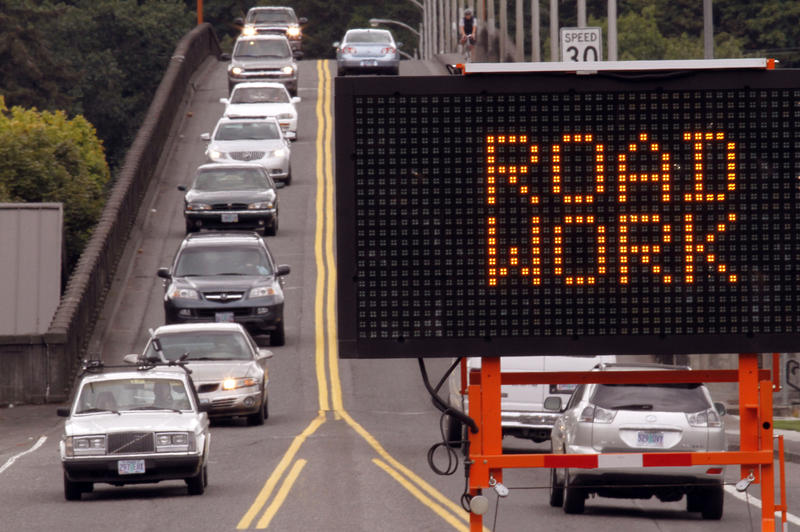 large sign warns drivers of upcoming road work on the Sellwood Bridge in Portland, Ore., Wednesday, Sept. 8, 2010.