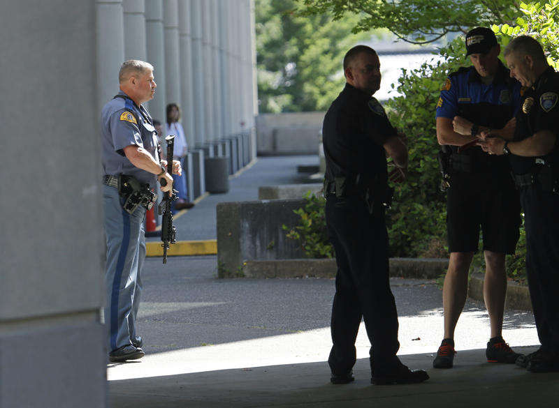 A Washington State Patrol trooper holds a gun after a lockdown at the state Capitol campus in Olympia, Wash. was lifted, Wednesday, July 12, 2017.