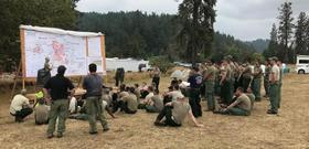 Task Force Spearhead soldiers briefed at Incident Command Center.