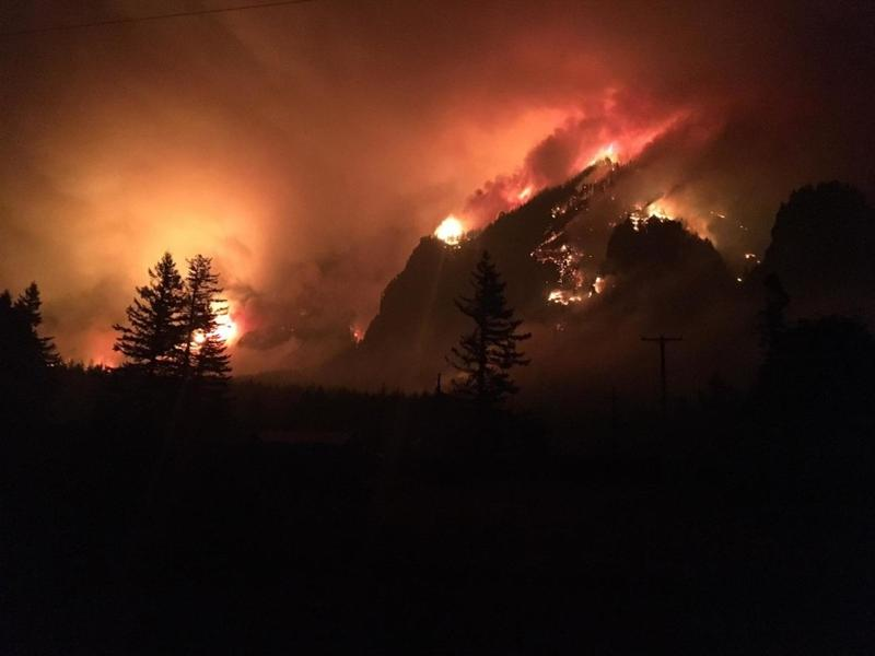 The Eagle Creek Fire swelled overnight Tuesday, burning more than 4,800 acres and threatening numerous structures along the Oregon side of the Columbia River Gorge.