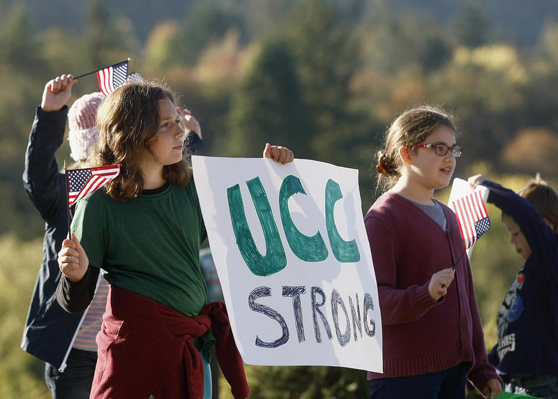 Nari Sarkissin, left, and Penny Lester, right, on Oct. 12, 2015 showing support to students returning to school for the first time after the deadliest shooting in state history on Oct. 1.
