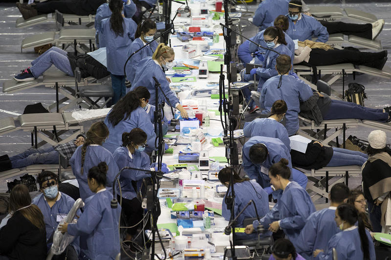File photo: Patients receive dental care during the Seattle/King County Clinic on Thursday, October 26, 2017, at Key Arena in Seattle.