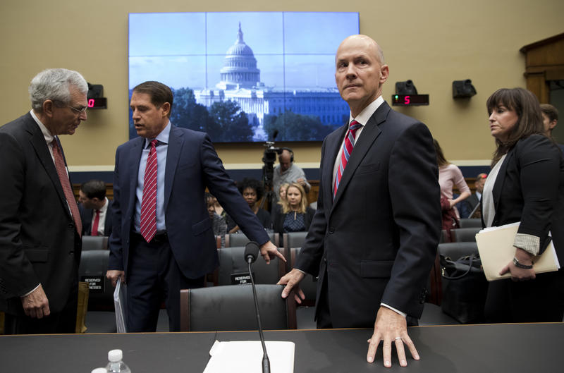 Former chairman and CEO of Equifax, Richard F. Smith, second from right, arrives to testify before the Digital Commerce and Consumer Protection Subcommittee of the House Commerce Committee on Capitol Hill in Washington.