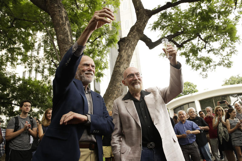 Scientists Barry Barish, left, and Kip Thorne, both of the California Institute of Technology, share a toast to celebrate winning the Nobel Prize in Physics Tuesday, Oct. 3, 2017, in Pasadena, California.