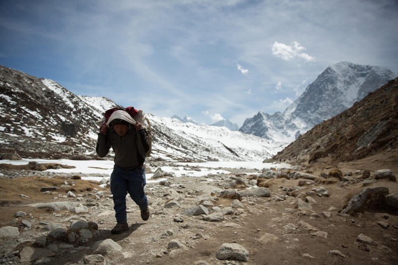 Sherpa carrying kit to base camp on Mount Everest.