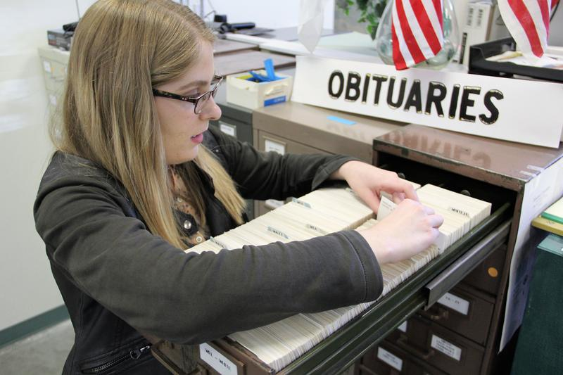 Katherine Barner looking though obituaries trying to connect Logan's family tree at the Yakima Geneology Library.