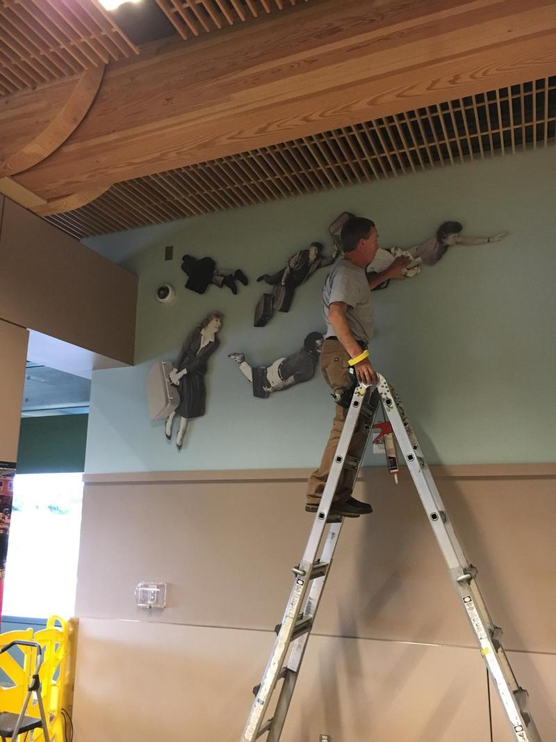 Flying People get reinstalled at Eugene Airport Thursday.