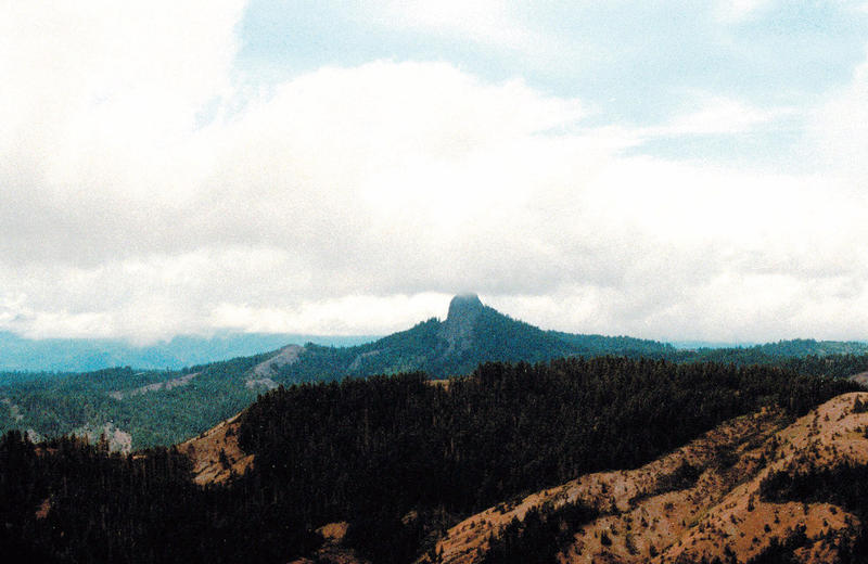 Pilot Rock rises into the clouds in the Cascade-Siskiyou National Monument near Lincoln, Ore.