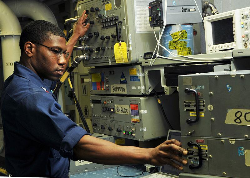 Naval Aviation Electronics Technician performing a sonar test.
