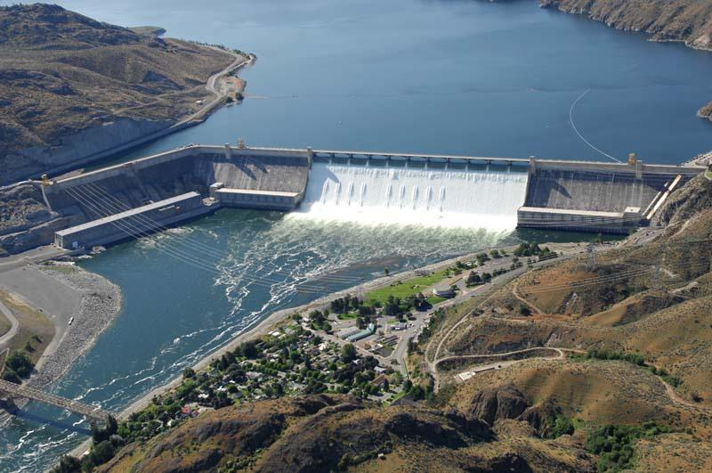 "The Grand Coulee Dam is one of many dams being ""drafted"" to release water."