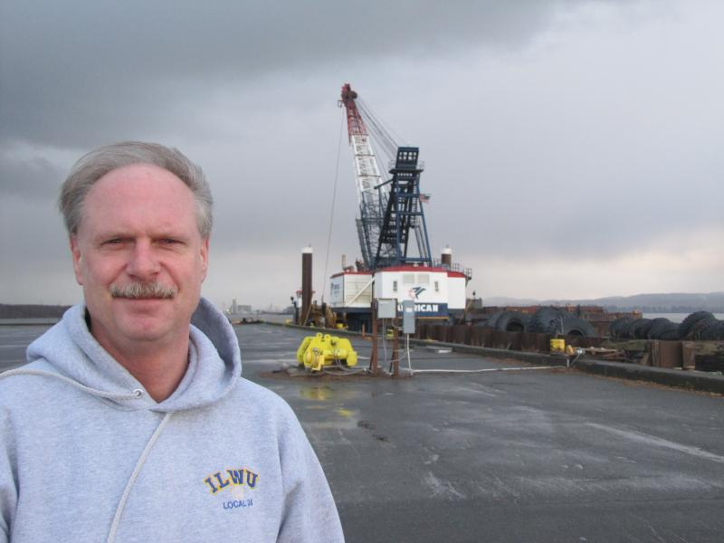 Tom O'Connor, a member of the Longshoreman's Union in Grays Harbor, standing at the site of the proposed new terminal.