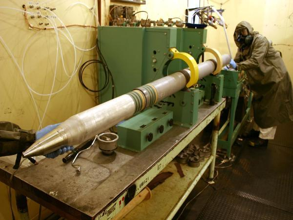 A chemical operations crew from the Umatilla Chemical Depot separate rocket motor and warhead sections on nine M55 rockets.