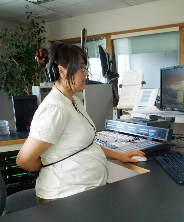 """Northwest Public Radio's Morning Edition host Sueann Ramella tries to use her left hand while working on the computer. """"I never realized how difficult it is to be a left-handed person in a right-handed world until Robin Rilette enlightened me."""""""