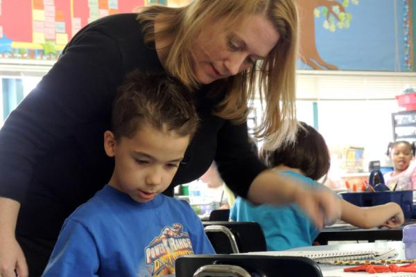 Jan LeBlanc, a teacher at Cherry Park Elementary, helps one of her students.
