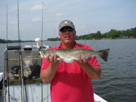 Capt. David Mason holding a tagged spotted seatrout from the Pamlico River, NC.