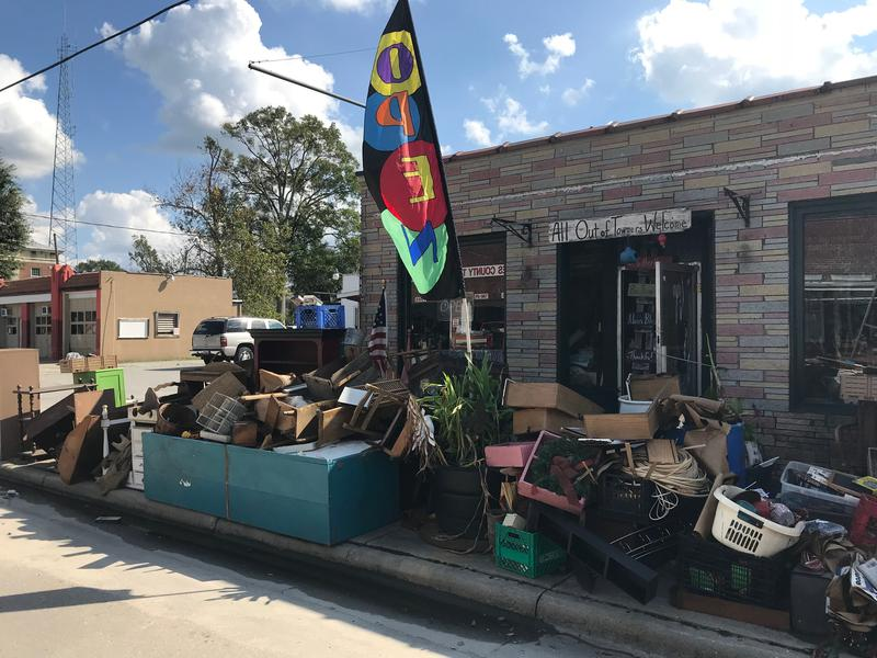 Water-damaged items from The Rag Bag, an eclectic shop in downtown Trenton, sit outside waiting to be removed on Wednesday, Sept. 26, 2018.