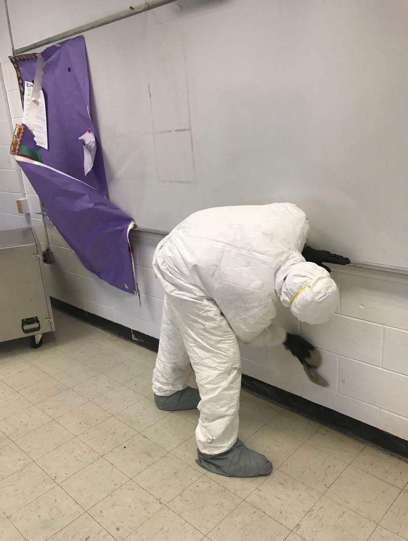 Crews were spread out throughout the science wing classrooms at White Oak High School cleaning the floors and walls after receiving several inches of rain inside during Hurricane Florence.
