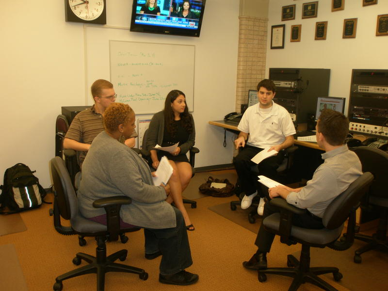 Morning editorial meeting in WFUV's Newsroom.